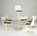 Eero saarinen for knoll international round tulip table with laminate top and six side chairs with vinyl upholstery table 29 x 48 dia