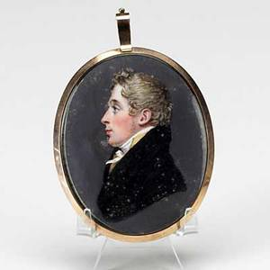 Miniature portrait on ivory mother of pearl backing under glass with blonde hair and seed pearl with enamel decoration 19th c low carat gold oval frame 2 14 x 3 14