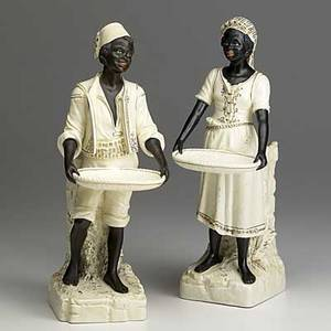 Pair of african figures painted bisque 19th20th c both holding trays 12 12