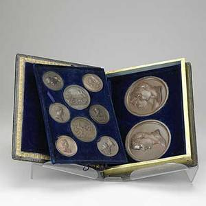 Ten french medallions relating to napoleon josephine and the french revolution 19th c in leather bound box all signed andrieu fecit largest 5 38 dia