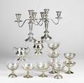 American silver pair of two arm weighted candelabra nine sterling coupes seven with glass inserts and weighted sterling creamer and sugar