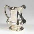 Gorham sterling silver water pitcher early 20th c bulbous square shaped form volutes and scrolls on handle rim and shaped ring foot letter mark ypo a7638 script monogram some dents 397 ot