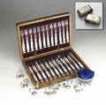Silver  silver plate table settings oak cased motherofpearl handled flatware with twelve knives and twelve forks eight weighted sterling asian figural place card holders two cartier napkin rings