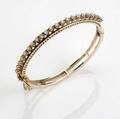Hinged gold  diamond bracelet with enamel 14k ca 1960 twentytwo full brilliant cut diamonds approx 110 cts tw 19 gs 2 14 x 1 78