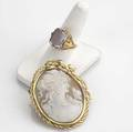 Gold  cameo jewelry shell cameo brooch with ornate 18k frame 2 14 together with a carved amethyst cameo and 14k ring size 8 12