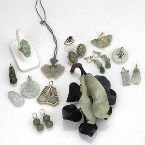 Jade  nephrite jewelry nineteen pieces 20th c seven pendants with gold fittings two 14k yg rings three pairs of earrings in vermeil and gf large decorative flower with six leaves two pendants w