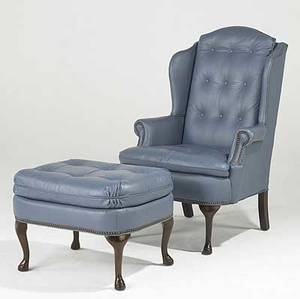 Queen anne style leather upholstered wing chair with matching ottoman 20th c 45 x 32 x 35