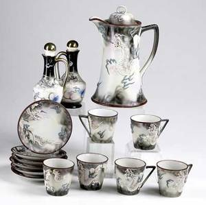 Japanese moriage fifteen piece chocolate set two cups with broken handles together with a pair of cruets all 20th c tallest 9