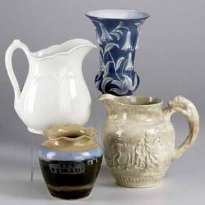 Decorative pottery four pieces include pheonix vase with floral decoration wedgwood dye ken john peel pitcher squat vase with landscape decoration marked cb craven and unmarked creamware pitcher