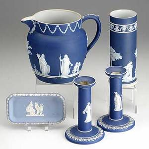 Wedgwood jasperware five pieces include pitcher pair of candlesticks vases and a pin tray all 20th c tallest 8