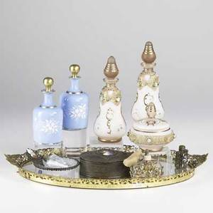 Perfume grouping eleven pieces include bottles trays and boxes oval mirrored tray oval box and painted porcelain plaque pair of enameled blue bottles two pink enameled bottle with matching box p
