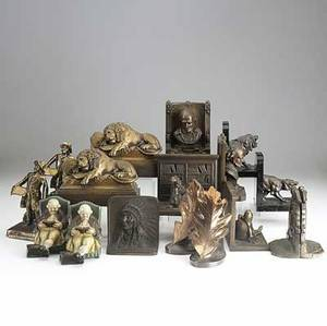 Nine pairs of bookends shakespeare recumbent lions town crier bradley and hubbard book reader liberty bell native american and others 20th century tallest 7