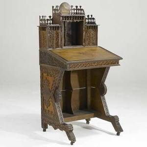 Tramp art desk with lift top and bookcase section applied decoration and fretwork molding across top ca 1900 52 x 26 x 22