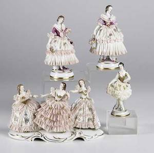 Four dresden porcelain figurines a triple figure of dancing figures together with three single figures each 20th c largest 10 x 5 x 6