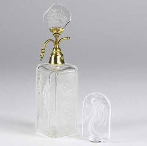 Hoffman perfume bottle in frosted and clear glass decorated with cherubs and a maiden butterfly visible inside collar together with a lalique hood ornament each 20th c taller 9