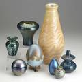 Studio art glass eight pieces include tall vase signed merritt pulled feather vase dated 1989 lundberg vase signed sanderson egg paperweights signed two small vases all 20th c tallest 13 3