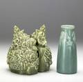 Rookwood three production items a pair of bookends with flower baskets and a vase all covered in matte green glaze all marked bookends 6 x 5 12 vase 6 14 x 2 12