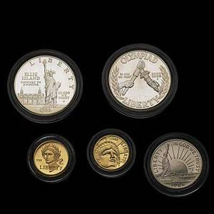 United states commemorative coins 1986 liberty three coin set 500 gold 100 silver and a 50 silver 1988 olympic two coin set 500 gold 100 silver and a 1988 olympic silver 100