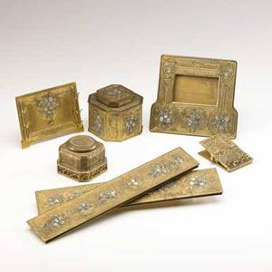 Tiffany studios seven desk set pieces in parcelgilt finish abalone pattern desk frame inkwell blotter ends and pen holder venetian pattern inkwell and paper clip all marked large inkwell 3