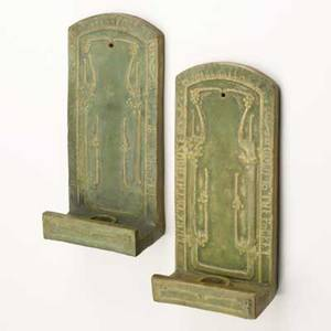 Arts and crafts pair of matte green candle sconces inscribed luck to the house  bayberry candle  gold to the pocket unmarked 9 x 4 14 x 2
