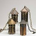 Arts  crafts lanterns group of four each with mica shade two brass washed one hammered copper and one patinated steel each with hanging chain tallest fixture 11
