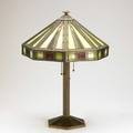 Bradley  hubbard table lamp with patinated white metal base and polychrome slag glass shade with white metal overlay base stamped bradley  hubbard 21 x 14 58 dia
