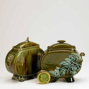 Chelsea keramic artworks low tile three pieces two similar covered pillow vases one decorated in relief with roses and silverplate snuff box inset with low tile medallion each marked tallest 9