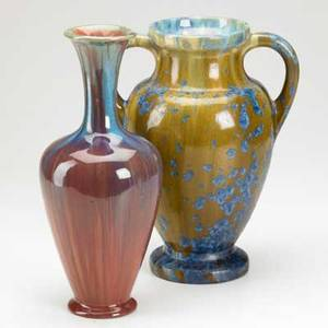 Pierrefonds twohandled urn decorated with blue and ochre crystalline glaze and a bottleshaped vase in mauve and blue glaze both with impressed mark taller 12
