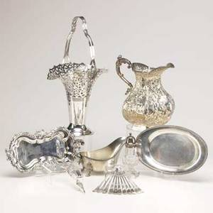 Ornate silver plate eighteen pieces ca 19001940 candle snuffer on tray gravy boat on tray pierced flower basket european style repousse water pitcher cut crystal sugar shaker 11 nut picks