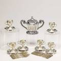 Continental silver twentyfour pieces set of six spun silver demitasse cups and saucers with engraved vacant cartouche fluted twohandled covered sugar bowl partial fruit service for six with figu