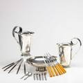 Danish modern silver plate and utensils twentytwo pieces 2 royal hickman water pitchers footed center bowl 7 knives with celluloid handles 5 knives with ebony handles 7 assorted utensil