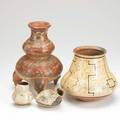 South american pottery four pieces three peruvian together with tripod vessel with eagle feet tallest 10 12