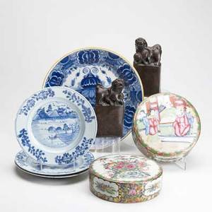 Pottery and porcelain eight pieces 19th c three asian blue and white decorated plates continental faience charger pair of chinese glazed redware foo dog bookends and a pair of famille rose lids