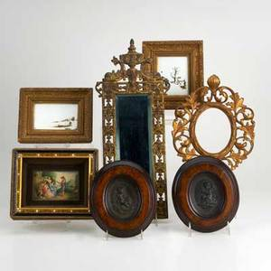 Decorative frames seven pieces 19th20th c gilt metal with beveled mirror and rococo design elements two bronze plaques depicting cherubs framed in walnut etc tallest 19