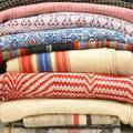 Coverlets and linens eleven pieces 19th early 20th c homespun cotton linen wool blue and white red and white etc 80 x 72