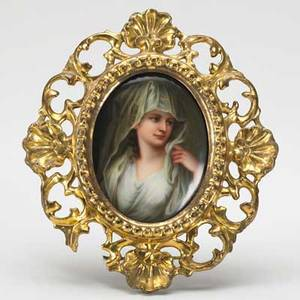 Painting on porcelain depicting a young woman in elaborate gesso frame 19th c unmarked 3 12 x 5 sight