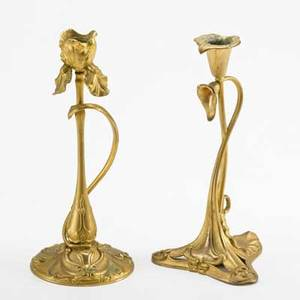Art nouveau two dore bronze candle sticks both foliate forms unmarked taller 10 14