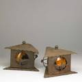 Pair of wrought iron lanterns triangularshaped with amber shades 20th c 8 x 10 12