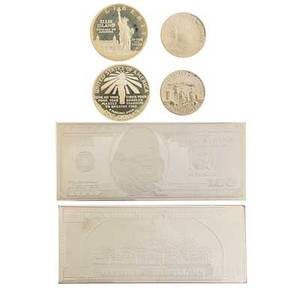 American coins and bullion approx twentythree items 20th c includes 2003 100 silver proof 4 ot silver bar 2 1986 liberty twocoin sets jfk plaque with two uncut 1964 half dollars etc
