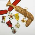 Middle eastern royal presentation items five 20th c 14k yg jambiya or dagger iran order of the crown breast medal with presentation scroll lebanon order of the cedar breast medal miniature and c