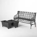 Garden furniture three pieces 20th c gothic style bench together with a pair of footed planters bench 33 12 x 55 12 x 19