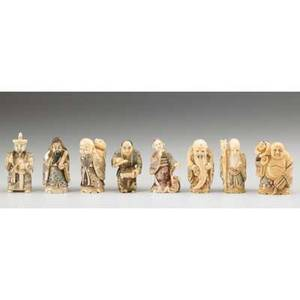 Japanese netsuke eight figural items including wise men and buddha in ivory or bone 19th20th c most marked tallest 2 14