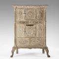 Continental cabinet paint decorated with sunburst decoration corner columns and paw feet 19th c 72 x 51 x 34