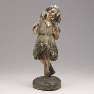 Continental carved wood figure depicting a hunter carrying game with polychrome decoration possibly italian 18th c losses 18
