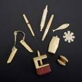 Ivory or bone sewing utensils nine pieces 19th20th c needle case clamp fish point pigs feet knitting needle holders waxer barrelshaped thread holder small needle case and flat winder la