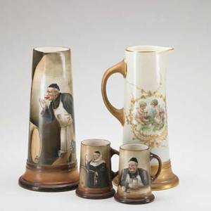 Trenton belleek handpainted pitcher and two mugs depicting monks enjoying food and drink together with a handpainted pitcher depiciting cherubs with gilt decoration late 19th c pitchers 14 12