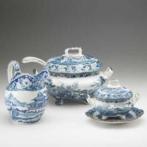Davenport four assembled pieces of blue and white transferware depicting pastoral or city scenes early 19th c includes soup tureen with ladle sauceboat with underplate and pitcher largest 9 14