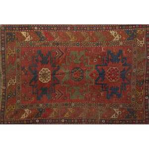 Caucasian oriental rug blue geometric design on red ground early 20th c 92 x 62