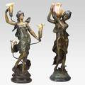 Two bronze figural lamps depicting classical females with foliate gold iridescent art glass shades 20th c taller 35