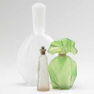 Ruba rombic etc green rombic perfume bottle together with deco store perfume display and lander narcissus atomizer 20th c tallest 13